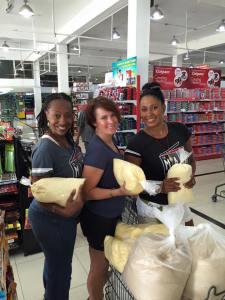 Jodi & Nichet w/ board member Heather buying bulk food for the orphanage we support in Jamaica.