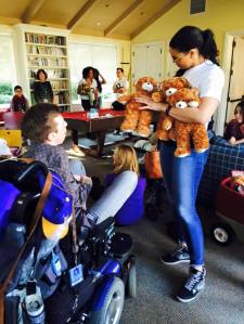 Handing out teddy bears at George Mark House, JSE2016