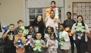 Jordin Sparks & Christian Covington with the kids from Bo's Place.